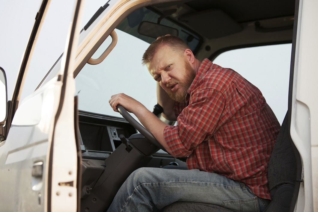 Somewhat puzzled bearded driver in the cab